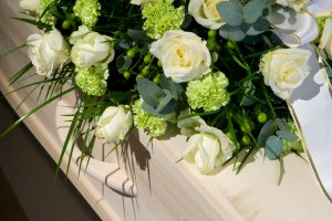 a-coffin-with-a-flower-arrangement-in-a-morgue
