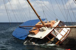 a-schooner-listing-to-its-side-and-slowly-sinking-300x200
