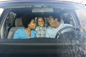parents-with-young-son-in-car-300x199