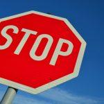 stop sign againt a blue sky