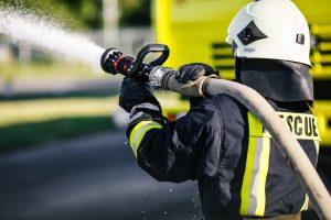 fireman using hose