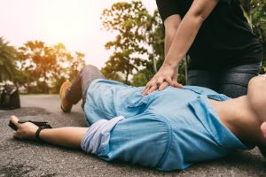 Emergency CPR on a Man who has Heart Attack , One Part of the Process of Resuscitation