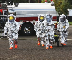 HAZMAT team is suited up with PPE to protect them from hazardous materials as they investigate this disaster