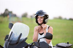 Pretty blond woman enjoying a motorbike ride in countryside