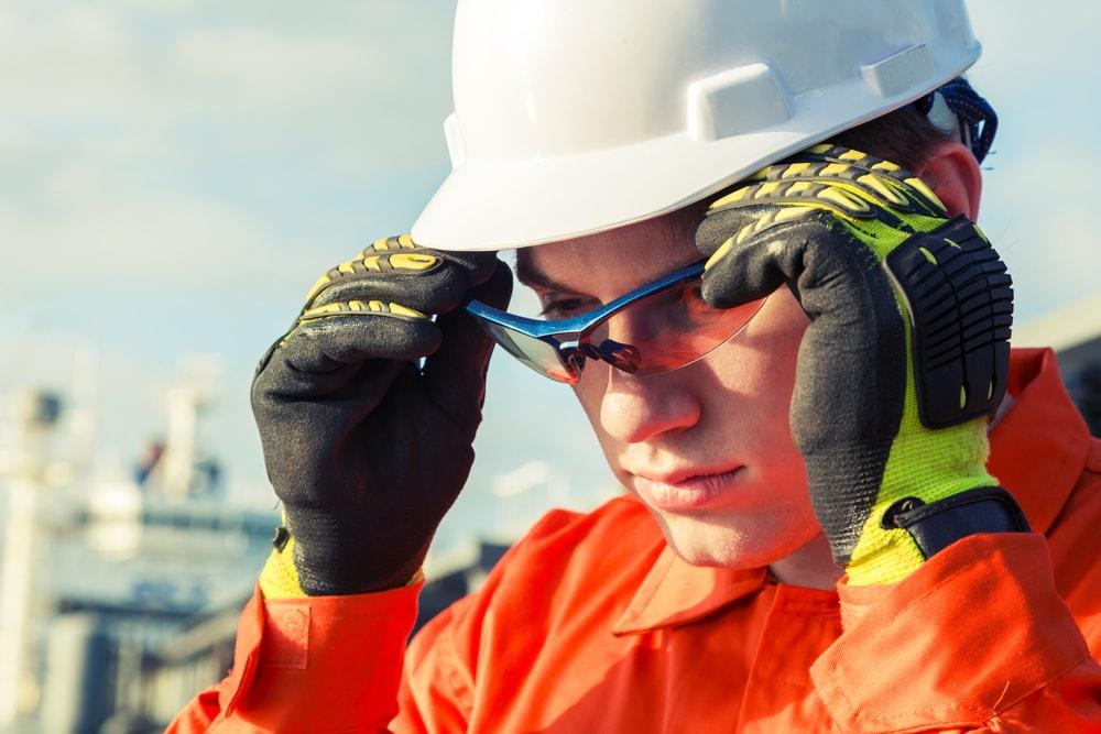 Orange robe engineer wearing safety glasses