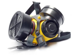 Respirator with interchangeable filter cartridges