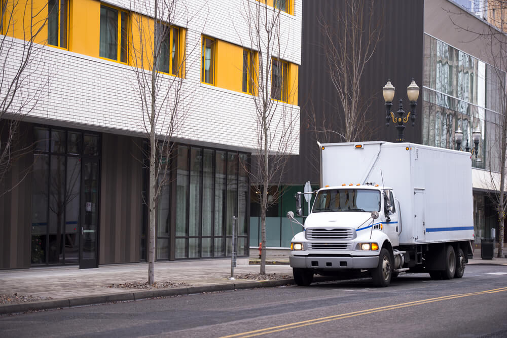 Small compact semi truck with a box trailer body