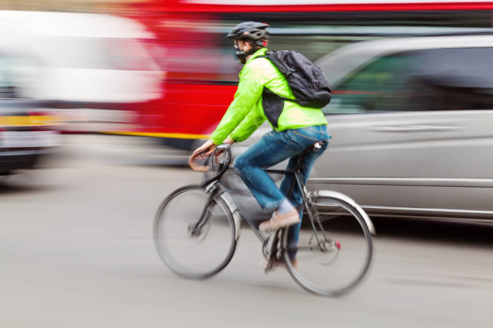 cyclists in motion blur in city traffic
