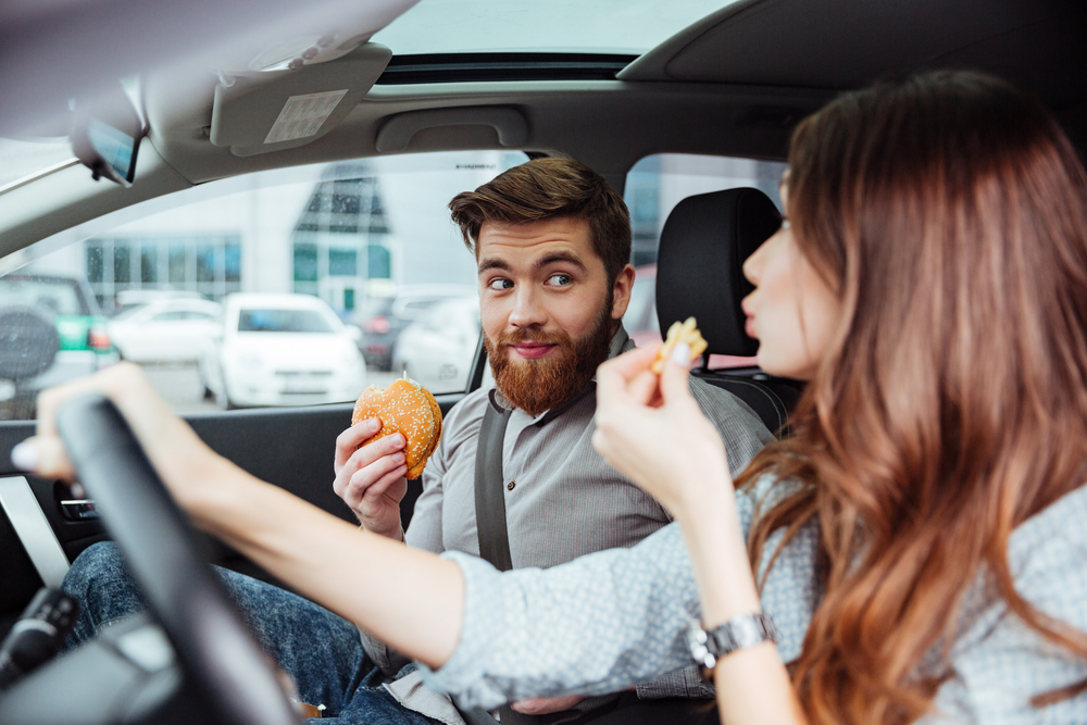 couple eating while driving