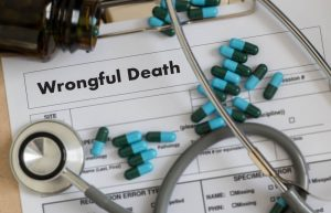pills and stethoscope on top of wrongful death document
