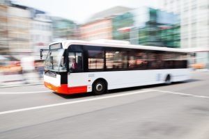 city bus driving fast