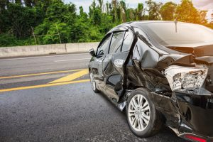 damaged car on the highway