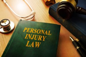 personal injury law book on desk with stethoscope